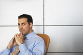 Businessman sitting in chair thinking — 图库照片