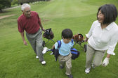 Grandparents playing golf with grandson — Stock Photo