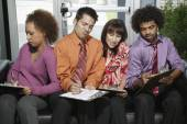 Business people filling out paperwork — Stock Photo