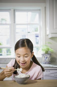 Asian girl eating rice — Stock Photo