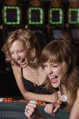 Women gambling at a casino — Stock Photo
