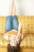 Woman talking on cell phone while laying upside down — Stock Photo
