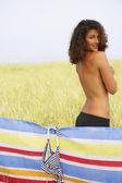 Semi-nude woman standing in field — Stock Photo