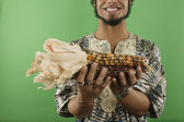 Midsection of man holding corn — Stock Photo