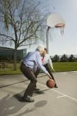 Two Hispanic businessmen playing basketball — Stock Photo