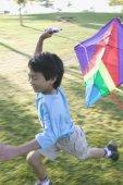 Boy running with kite — Stock Photo