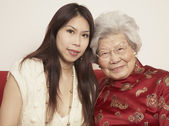 Asian grandmother with adult granddaughter smiling — Stock Photo