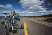 Young boy on toy motorcycle — Stock Photo