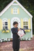 Boy putting dollar in piggy bank — Stock Photo