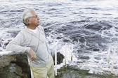 Man standing on stairs by the sea — Stock Photo
