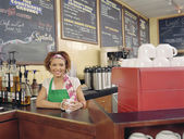 Barista smiling for the camera — Stock Photo