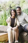 Middle-aged African couple smiling on dock — Stock Photo