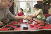 Children playing checkers — Stock Photo