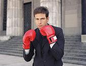 Businessman wearing boxing gloves — Стоковое фото