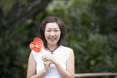 Asian woman holding flower — Stock Photo