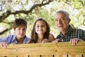 Hispanic family smiling outdoors — Stock Photo
