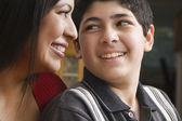 Hispanic mother and son smiling at each other — Stock Photo