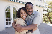 African American couple hugging outdoors — Stock Photo