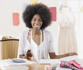 African seamstress in design workshop — Stock Photo