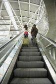 Couple on escalator — Stock Photo