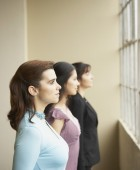 Businesswomen lined up at window — Stock Photo