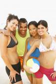 Multi-ethnic friends holding volleyball — Stock Photo