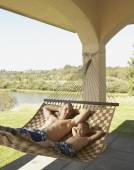 Father and son relaxing in a hammock — Stock Photo