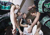 Girls basketball team in huddle with coach — Stock Photo