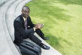 Businessman holding electronic organizer — Stock Photo