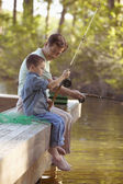 Grandfather fishing with grandson — Stock Photo