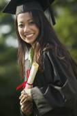 Young woman graduating — Stock Photo