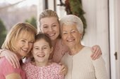 Female family members hugging and smiling — Stock Photo