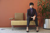 Asian businesswoman in waiting area — Stock Photo