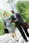 Businesspeople descending steps together — Stock Photo