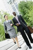Businesspeople descending steps together — Stock Photo