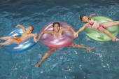 Young girls floating in inner tubes — Stock Photo