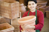 Hispanic boy working at garden center — Stock Photo