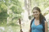 Young woman hiking in a forest — Stock Photo