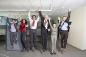 Group of coworkers jumping — Stock Photo