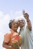 Senior African couple taking own photograph — Stock Photo