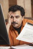 Hispanic businessman holding graph — Stock Photo