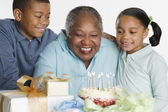 Senior woman celebrating her birthday — Stock Photo