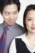 Asian businessman looking at Asian businesswoman — Stock Photo