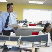 Businessman and woman working in office — Stock Photo