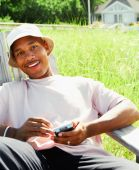 Young man using electronic organizer outdoors — Stock Photo