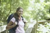 Female hiker on a trail walkway — Stock Photo