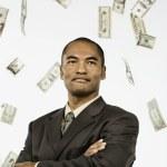 Money raining down on Asian businessman — Stock Photo #52040057