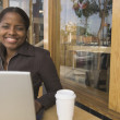 African businesswoman with laptop at cafe — Stock Photo #52040173