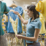 Hispanic teenage girl in clothing store — Stock Photo #52040255
