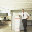 Businessman smiling for the camera in empty office space — Stock Photo #52040285